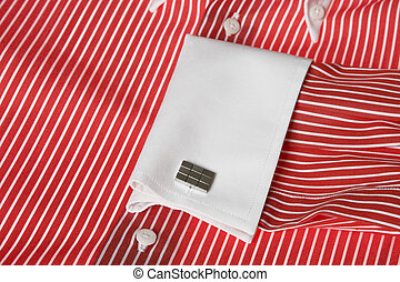 cuff link on men's red shirt - Close-up of cuff link on...