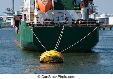 moored tanker - tanker moored at a yellow buoy in the...