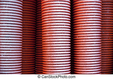 Red plastic pipes - Stack of red plastic pipes with hoar...