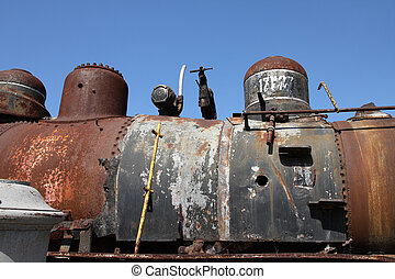 Junk - Close up of an old, rusty steam locomotive ready to...
