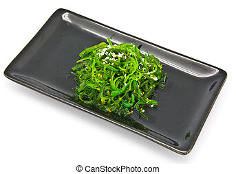 Japanese Cuisine , Seaweed Salad in black plate on white...