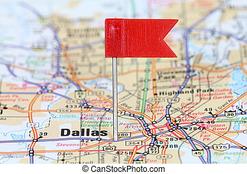 Dallas, Texas. Red flag pin on an old map showing travel...