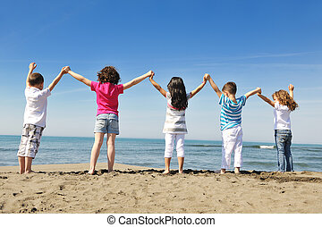 happy child group playing on beach - group of happy child on...