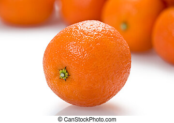 Clementine - One whole clementine orange with several more...