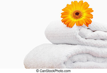 Close up of a sunflower on white towels