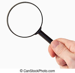 Hand holding a magnifying glass against a white background