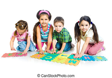 children are playing letters ; isolated on the white...