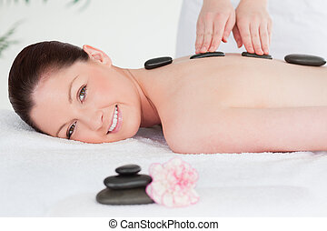 Beautiful woman having a Stone therapy