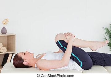 Athletic woman stretching her leg