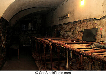 Abandoned prison cell foto illuminated by lamp - Abandoned...
