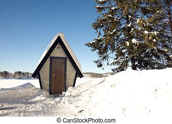 Very small house in winter