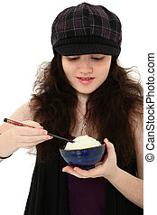 Young Woman Eating Rice with Chopsticks - Attractive 18 year...