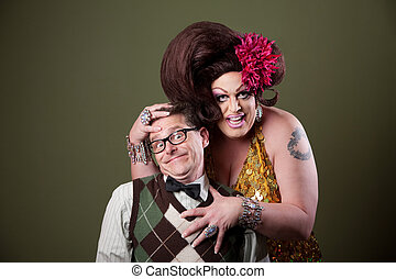 Drag Queen Holding Nerd - Drag queen holds a Caucasian nerd...
