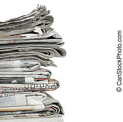 newspaper over white background - shot of stack of newspaper...