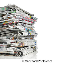 newspaper over white background - shot of pile of newspaper...