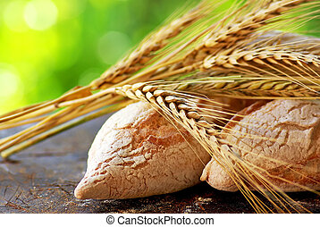Portuguese bread and spikes of wheat. - Portuguese bread and...