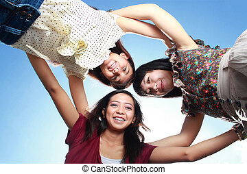 having fun with friends - young asian woman having fun with...