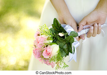 Bridal Bouquet - Bride holding her bouquet behind her back