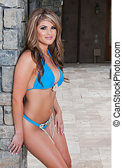 Latina - Beautiful young Latina in a blue bikini