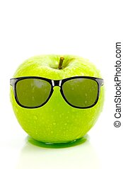 Green Apples - A green apple isolated against a white...