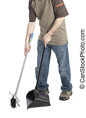 man sweeping dirt into a dustpan isolated on white...
