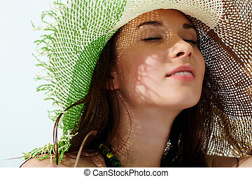 Sensual girl - Close-up of a girl?s face in straw hat...
