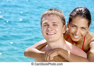 Togetherness - Close-up of smiling girl hugging her...