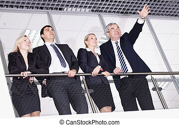 Perspectives - Group of businesspeople with their senior...
