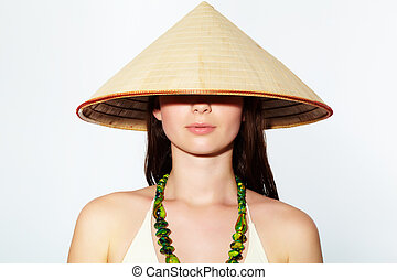 Girl in Vietnamese hat - Portrait of a young girl in...