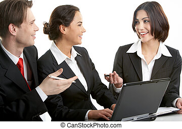 Discussion of work - Three businesspeople sitting at table...