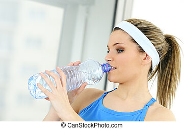 bottle of water - young sportive adult is drinking fresh...