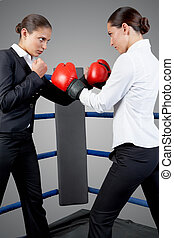 Fighting females - Photo of aggressive business women...
