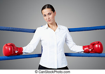 Bossy woman - Portrait of strict businesswoman in boxing...