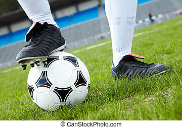 Foot on ball - Horizontal image of soccer ball with foot of...