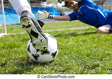 Before goal - Horizontal image of soccer ball with foot of...