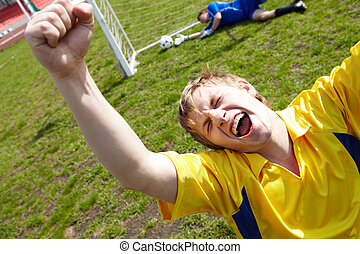 Goal - Image of soccer player shouting in joy