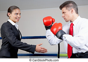 Opposition - Portrait of aggressive businessman in boxing...