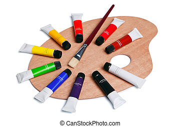 Wooden palette with tubes of paint isolated on white - Photo...