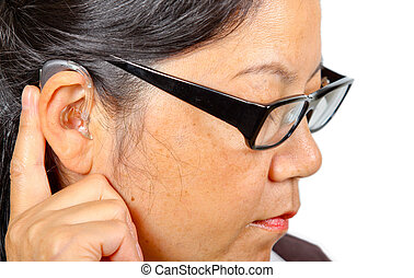 woman with eyeglasses wearing hearing aid - Asian woman with...