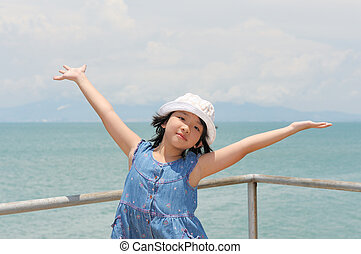 Asian kid on the shore - Asian kid opening arms on the shore