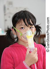Asian kid taking respiratory therapy