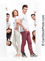 young couple and friends advertising - young couple between...