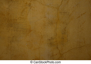 Honey colored cracked plaster wall textured background
