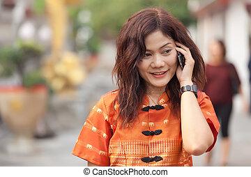 asian woman phoning