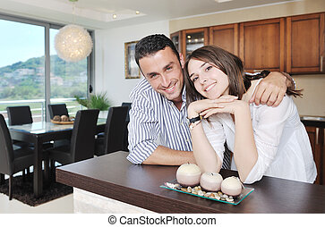 happy young couple have fun in modern kitchen - happy young...
