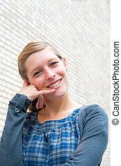 woman talk on a cellular telephone