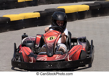 driver on circuit, kart riding on the outer circuit