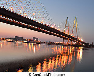 Big cable-stayed bridge in night, St.Petersburg, Russia