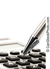 Calculator and pen - A calculator and a pen in the...