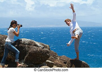 Falling - A woman is taking a picture of a man, who appears...